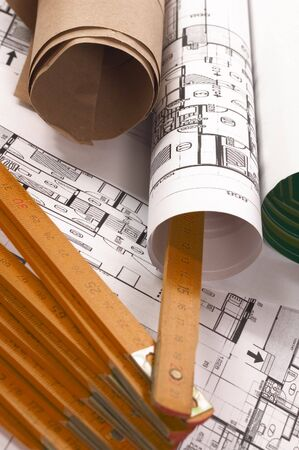 metre: Architecture planning of interiors with scrolled paper and metre
