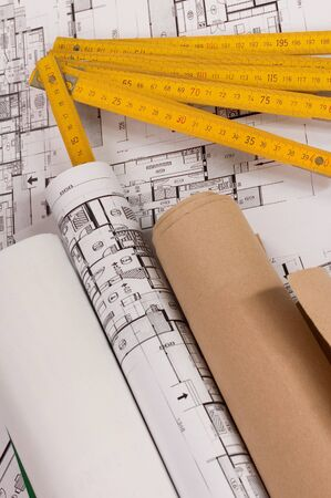 wooden metre: Architecture planning of interiors designe on paper with wooden metre Stock Photo