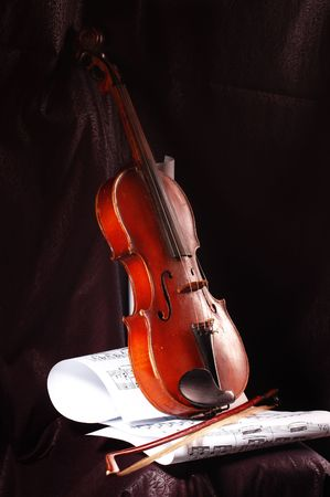 Composition of music notes with old violin
