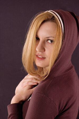earnestly: Close up portrait of young beautiful girl with hood