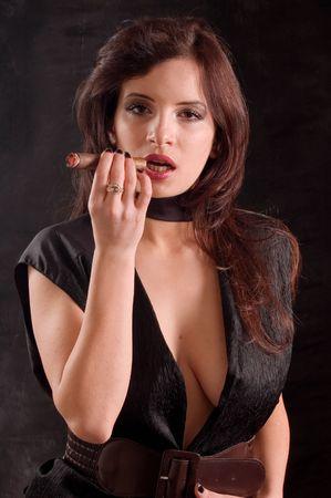 cigar smoking woman: A young sensual fashion woman smoking cigarette