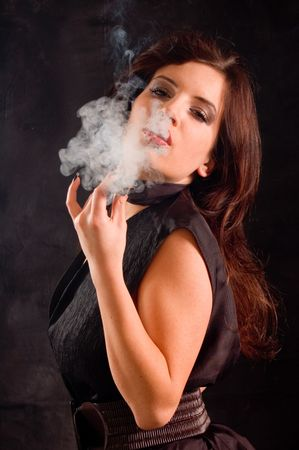cigar smoke: Portrait young woman with column of smoke Stock Photo
