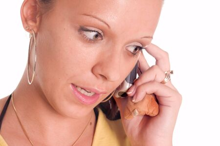 telework: Young woman making a mobile call with friend Stock Photo