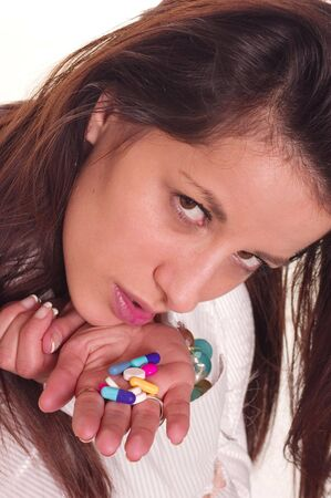 dieta: Young woman holding pills for protection her health   Stock Photo