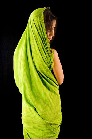 Young adult girl posing drapped with green fabric textile photo