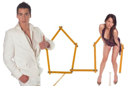wooden metre: Young couple with model house of wooden metre