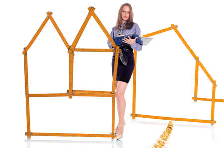 metre: Female architect planning house from model of wooden metre Stock Photo