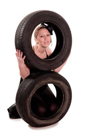 Young sexy girl with a two car wheel Stock Photo - 2671196