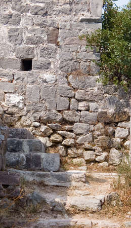 loophole: Loophole on the stone wall for rifle fire on ruin of castle from middle ages Stock Photo