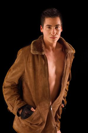 Naked torso of man covered with leather coat photo