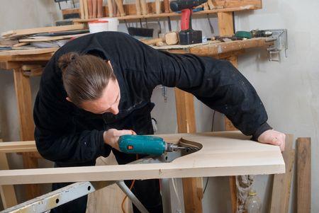 carpenter's bench: Carpenter bore a hole in the door on carpenters bench