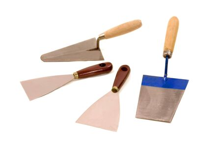 housepainter: Bricklayers and housepainters trowels, construction equipment on white backgrounds