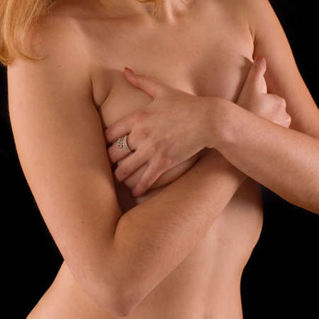 Naked torso of womans body on black backgrounds photo