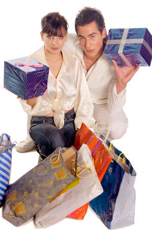 Young man and woman holding bags and presents Stock Photo - 2863744