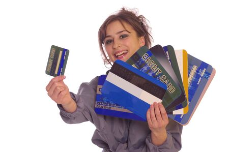 creditcards: Young woman holding small and large internet credit cards