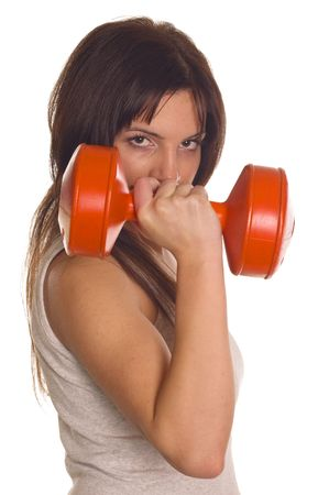 Gym fitness girl training her body with dumbbell    photo