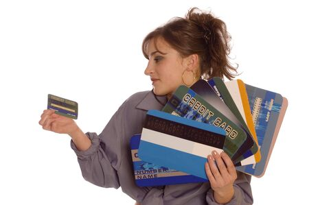 creditcards: Young woman holding one small and a lot of large credit cards on white backgrounds