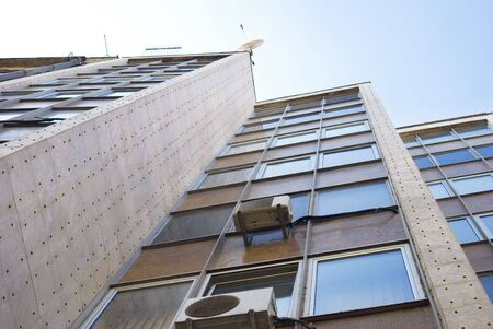 Office building of modern city against sky in Belgrade photo