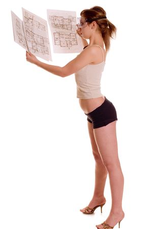 Sexy woman holding architecture planning of her house photo