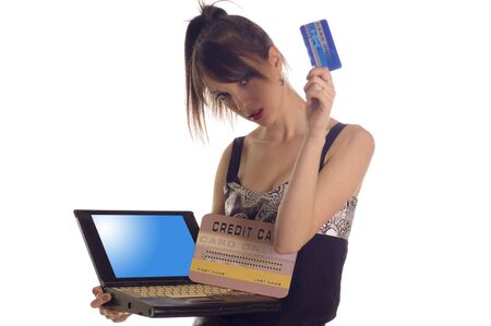 creditcards: Young woman holding internet credit cards on white backgrounds     Stock Photo
