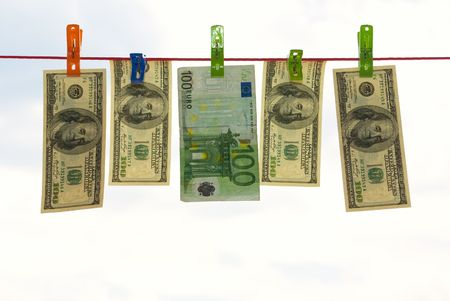hung: Money, dollars and euro hung on clothesline