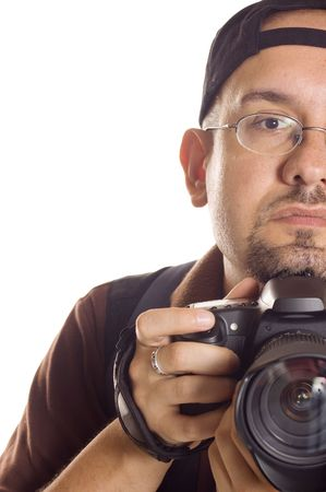 photography session: Young man with digital camera taking picture