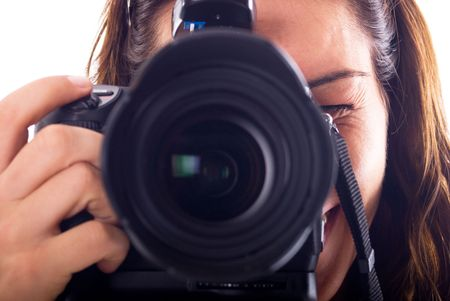 Young woman with digital camera taking picture