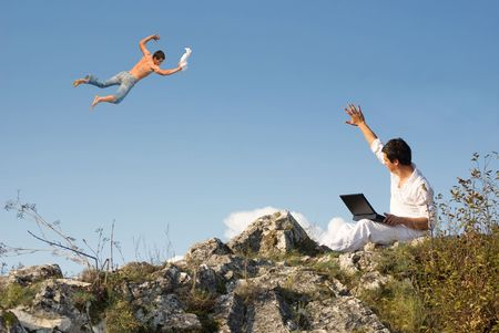 demonstrate: Man with laptop demonstrate his magic power to flying man on the sky