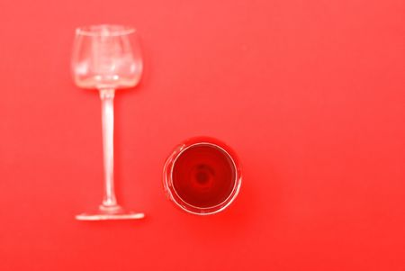 overturn: Two glasses, one is full of red wine, second is empty and overturn Stock Photo