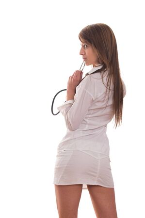 Young woman doctor with stethoscope standing photo
