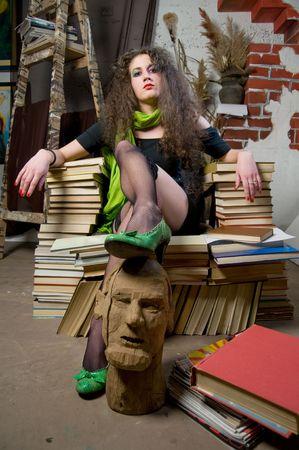 fine arts: Woman sitting on armchair of books at fine arts atelier