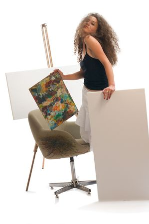 Young woman at atelier with canvas photo