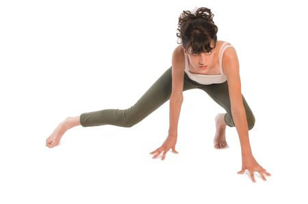 Young teenager girl practicing gymnastic on white Stock Photo - 6698292