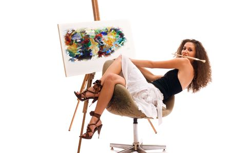 Young woman at atelier with canvas