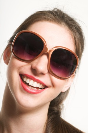 funy: Portrait of smiling beautiful young woman with funy sunglasses