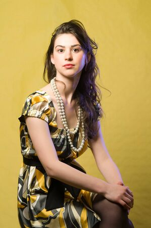 earnestly: Portrait of grave and beautiful young woman, studio shoot Stock Photo