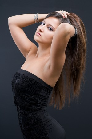 Attractive woman in evening gown on dark backgrouinds Stock Photo - 8048389