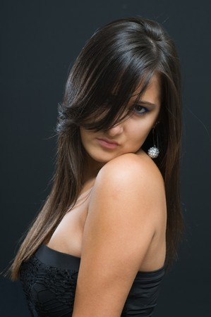 Porttrait attractive woman with long brown hair on black Stock Photo - 8048393