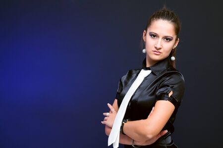 Confident businesswoman standing with arms crossed looking at camera photo