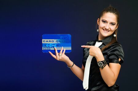 Young woman holding and showing at credit card-modern way of paying photo