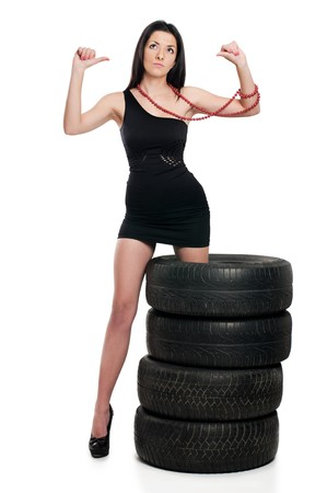 Young sexy woman like vulcaniser with a automobile tire Stock Photo - 8258314