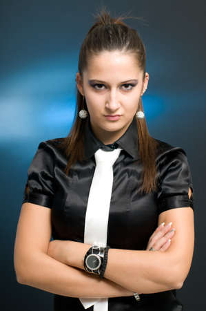 Confident businesswoman with arms crossed and white necktie looking at camera photo