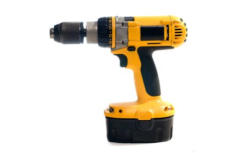 charger: Yellow hand electric drill on battery charger