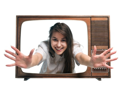 Old vintage tv with young woman arms outstretched from screen photo