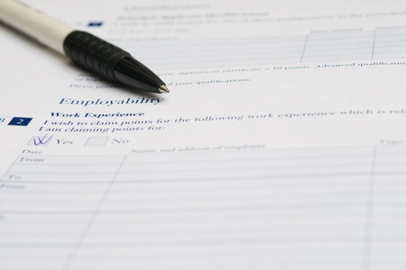 Pen and application form for work experience that requires to fill out his required information. Stock Photo