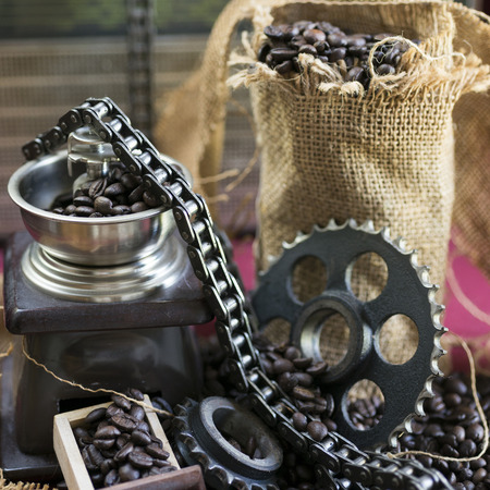 sprockets: Gear, sprockets, chain for car engine, coffee and texture of burlap sock Stock Photo