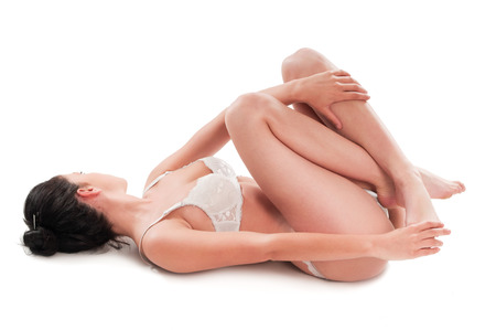 strenuous: Young woman lying with relax pose, she rest ones her feet after strenuous day work