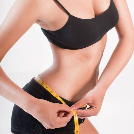 cintura perfecta: Mujer que mide su cintura perfecta