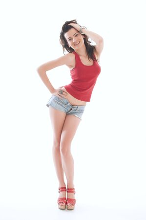 charming girl: Beautiful young female at provocative posing in shorts