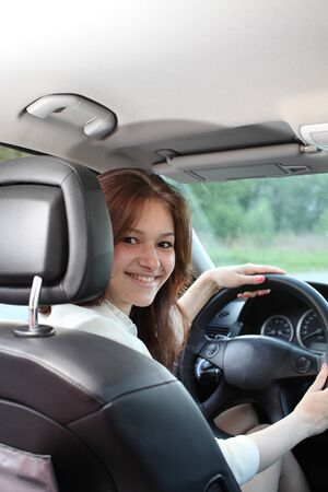 young beautiful woman driving a car photo